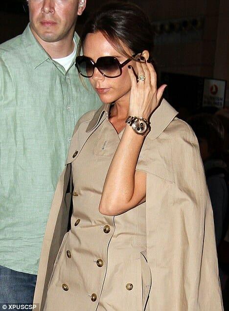 Victoria Beckham wearing a gold Rolex Daytona